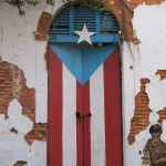 Rustic wooden door with Puerto Rican flag in Old San Juan, Puerto Rico
